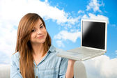 Young woman showing laptop. — Stock Photo