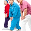 Senior women streching legs. — Stock Photo