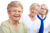 Elderly woman portrait with girlfriends. — Stock Photo