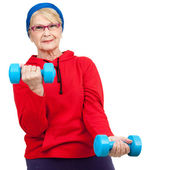 Elderly woman with weights. — Stock Photo