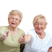 Two Elderly woman showing thumbs up. — Stock Photo