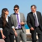 Business team having a walk outdoors. — Stock Photo