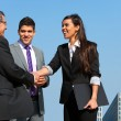 Business team shaking hands over deal outdoors. — Stock Photo