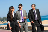 Business team having a walk outdoors. — Stock Photo
