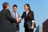 Business team shaking hands over deal outdoors. — Foto Stock