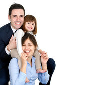 Happy young couple with their daughter — Stock Photo