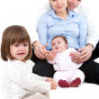 Unhappy jealous little girl with family — Stock Photo #9346961