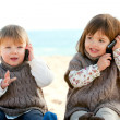 Two baby girls talking on mobile phones. — Stock Photo #9348009