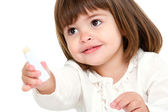 Portrait of little girl with lip balm. — Stock Photo