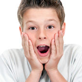 Close up of boy with surprising face expression. — Stock Photo