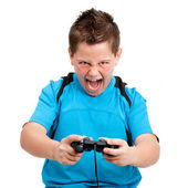 Boy with winning attitude playing with console — Stock Photo