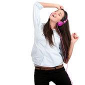 Jonge vrouw met een roze hoofdtelefoon. — Stockfoto