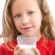 Close up of young girl drinking milk. — Stock Photo