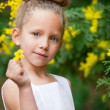 Portrait of Cute girl with flower oudoors. — Stock Photo