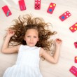 Young girl on floor with domino pieces — Stock Photo #9394449