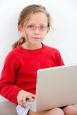 Portrait of young girl with laptop. — Stock Photo