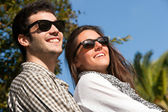Close up portrait of couple with sunglasses — Stock Photo