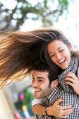 Happy couple having fun outdoors. — Stock Photo