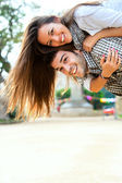 Young couple having great time outdoors. — Stock Photo
