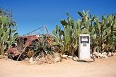 Old gas station with wreck of car — Stock Photo