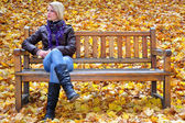 Young blonde girl relaxing in park — Stock Photo