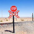 Warning of road sign - stop and railway cross the road — Stock Photo