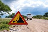 Warning of road sign - falling stones on the road — Stock Photo