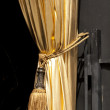 Gold curtain with a tassel — Stock Photo