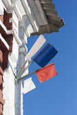 Three small flags on the old house — Стоковое фото