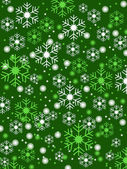 Snowflakes green background — Stock Vector