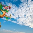 Chinese dragon wrapped around pole - Stock Photo