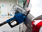 A car at gas station being filled with fuel — Stock Photo