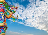 Chinese dragon wrapped around pole — Stock Photo