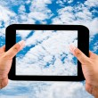 Stock Photo: Tablet in hands on blue sky background