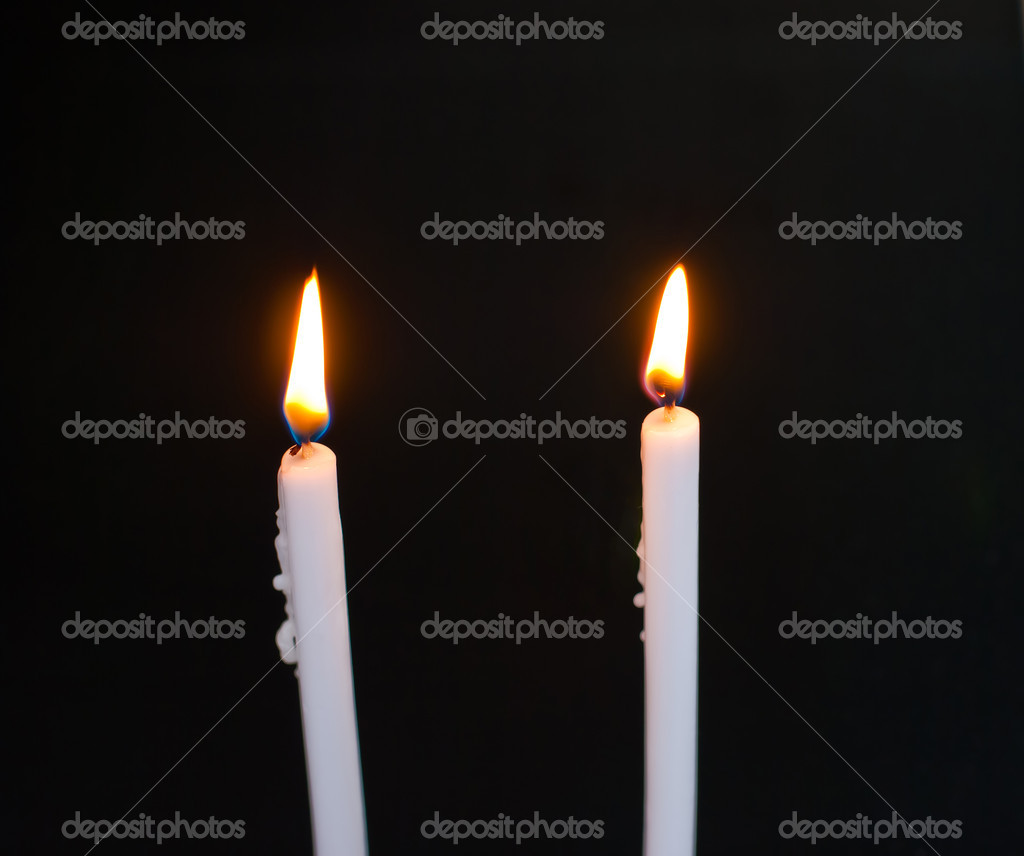 Candles flame on black background — Photo #10272617