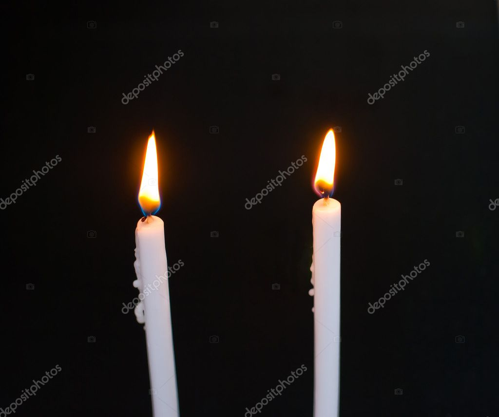 Candles flame on black background — Stockfoto #10272617