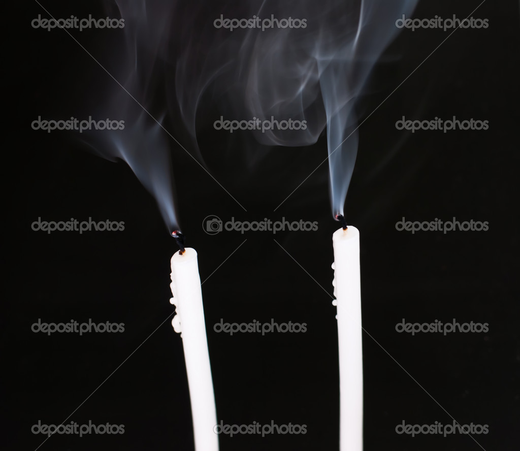 Candles with smoke on black background — Stock Photo #10272665