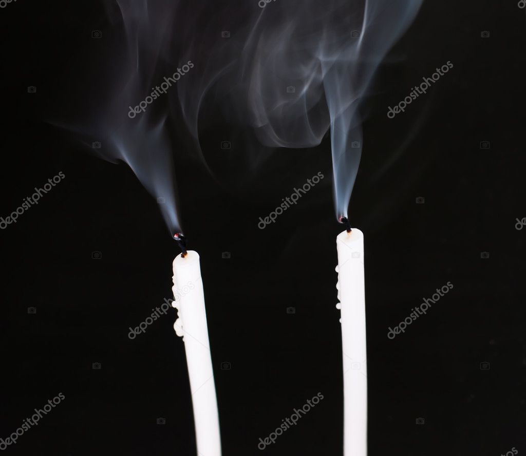 Candles with smoke on black background — Photo #10272665