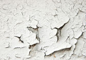Old cracked paint on the concrete wall — Stock Photo