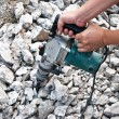 Worker using hammer drill for boring concrete - Stock Photo