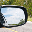 Sky in car mirror — Stock Photo #10415894