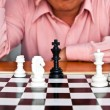 Stock Photo: Mthinking about chess strategy