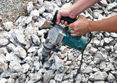 Worker using hammer drill for boring concrete — Stock Photo