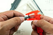 Technical drawing and tools in hand — Stock Photo