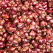 Stock Photo: Fresh shallots stacked on market