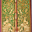 Pattern in traditional Thai style art on door of the temple in Thailand - Stock Photo