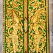 Pattern in traditional Thai style art on door of the temple in Thailand — Stock Photo