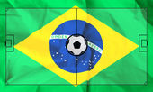 Soccer field layout on realistic Brazil flag background — Stock Photo