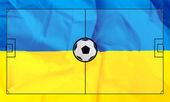 Soccer field layout on realistic Ukraine flag background — Stock fotografie
