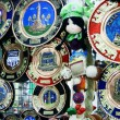 Dolls and Decorative Plates at a market in Ecuador - Stock Photo